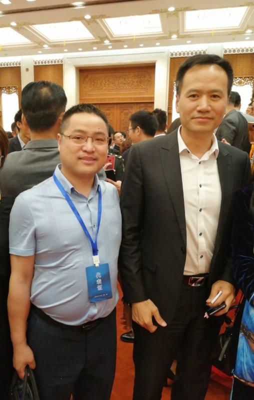阿里巴巴原副总裁与北京金剪子服装科技有限公司总经理林陈桥亲切合影